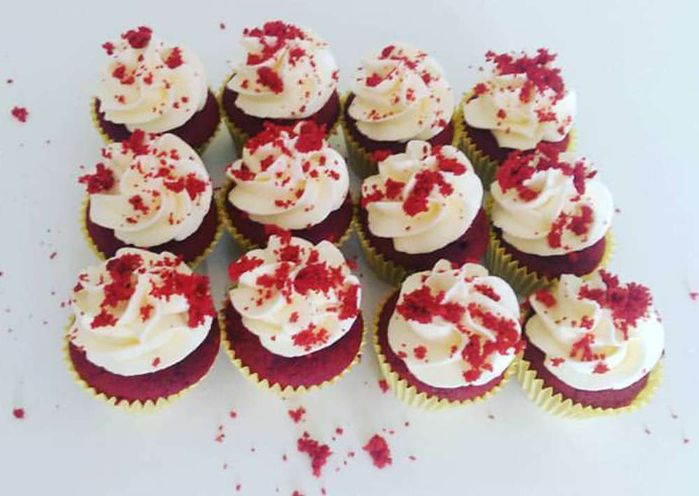 Red Velvet Cupcakes with crumbled red velvet top